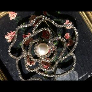 Elegant and Ladylike Pin/Brooches. Center is Pearl